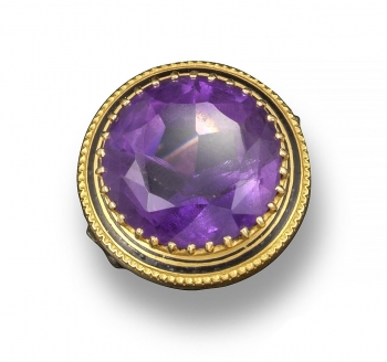A Victorian amethyst-set gold ring, the circular-cut amethyst is set within a border of black enamel